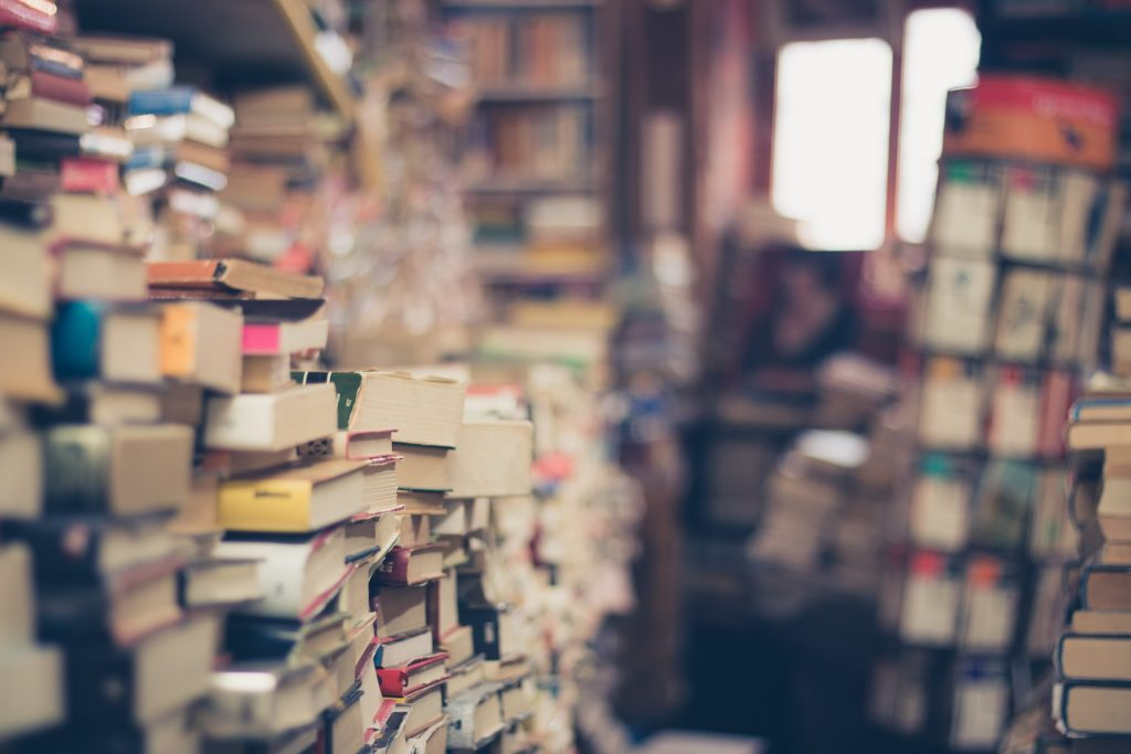 Piles of books stacked up to ceiling by someone with hoarding disorder