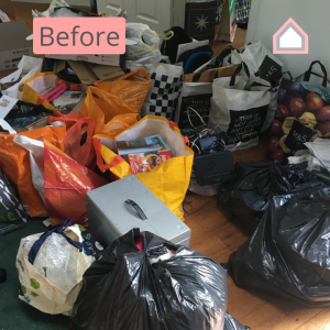 Before photo - hoarding disorder cluttered room
