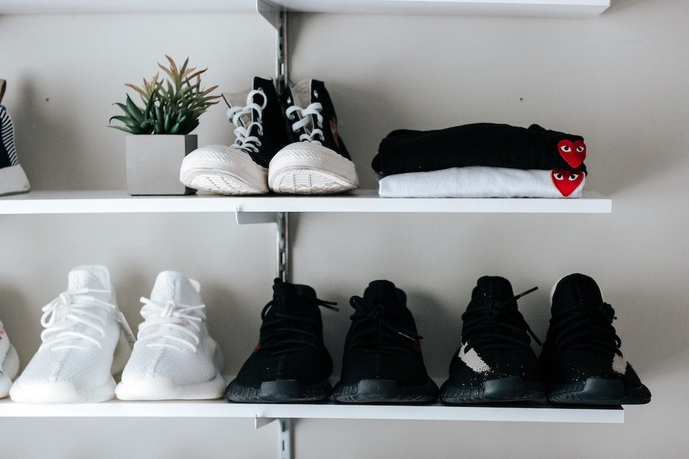 Shoes organised on shelves